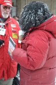 A musher is given her cache of Trail Mail at the Ceremonial Start in 2012